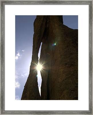 Sunburst Through Granite Framed Print by Sally Weigand