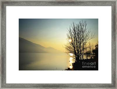 Sunlight On An Alpine Lake Framed Print by Mats Silvan