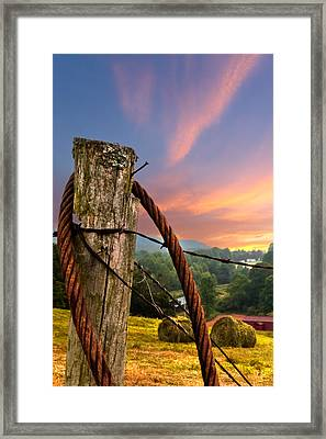 Sunrise Lasso Framed Print by Debra and Dave Vanderlaan
