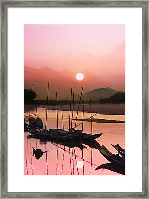 sunset at Mae Khong river Framed Print by Setsiri Silapasuwanchai