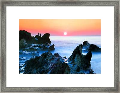 Sunset At Sea With Rocks In Foreground Framed Print by Midori Chan-lilliphoto