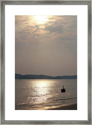 Sunset At The Beach Framed Print by Nawarat Namphon