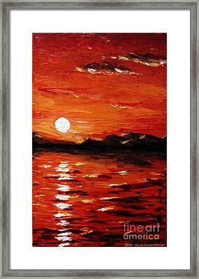 Sunset On The Sea Framed Print by Muna Abdurrahman