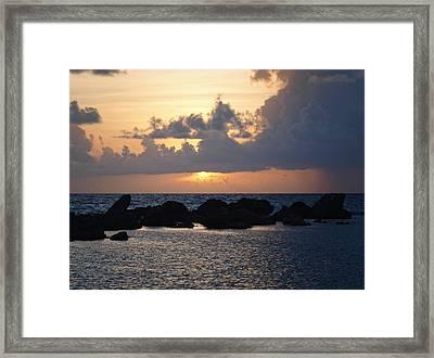 Sunset Over The Ocean Framed Print by Philip G