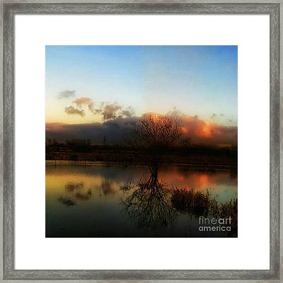 Sunset Reflections Framed Print by Isabella Abbie Shores