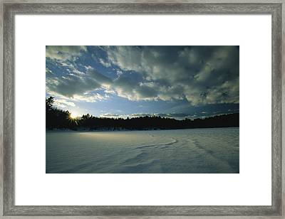 Sunset Viewed From The Frozen Surface Framed Print by Tim Laman