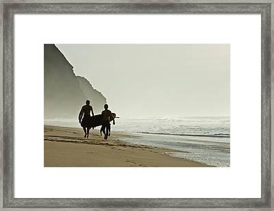 Surfers Framed Print by Daniel Kulinski