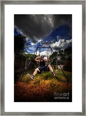Swinger Framed Print by Yhun Suarez