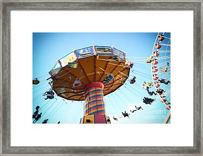 Swings Framed Print by Leslie Leda
