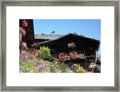 Swiss Chalet Interlaken Framed Print by Marilyn Dunlap