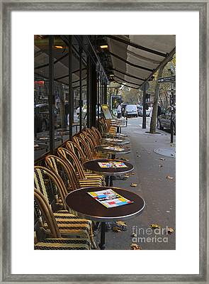 Tables Outside A Paris Bistro On An Autumn Day Framed Print by Louise Heusinkveld