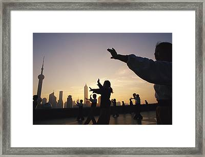 Tai Chi On The Bund In The Morning Framed Print by Justin Guariglia