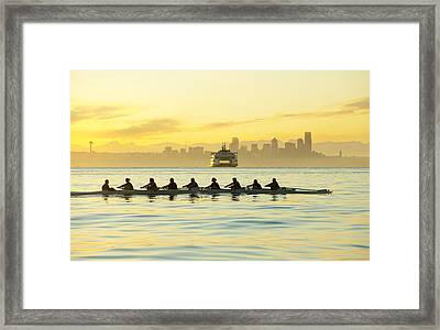 Team Rowing Boat In Bay Framed Print by Pete Saloutos