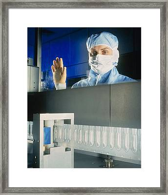 Technician Monitoring Suppository Drug Production Framed Print by Geoff Tompkinson