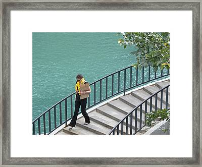 Texting As She Goes Framed Print by Ann Horn