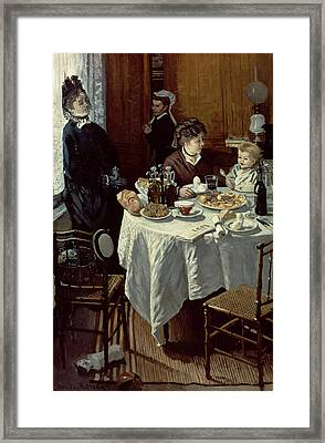 The Breakfast Framed Print by Claude Monet