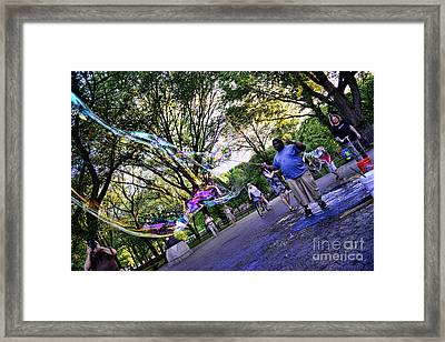 The Bubble Man Of Central Park Framed Print by Paul Ward