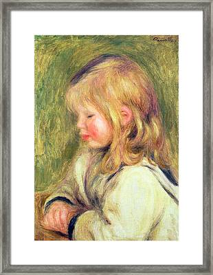 The Child In A White Shirt Reading Framed Print by Pierre Auguste Renoir