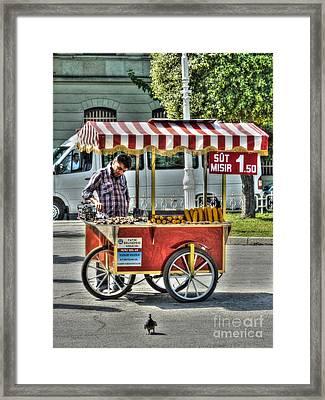 The Corn Vendor Framed Print by Michael Garyet