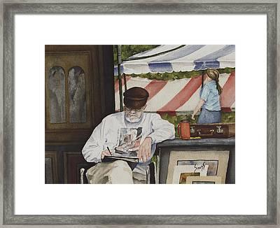 The Festival Artist Framed Print by Sam Sidders