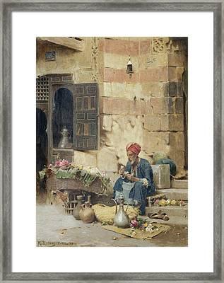 The Flower Seller Framed Print by Raphael von Ambros