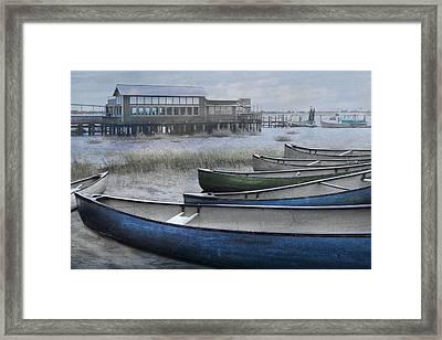 The Green Canoe Framed Print by Debra and Dave Vanderlaan