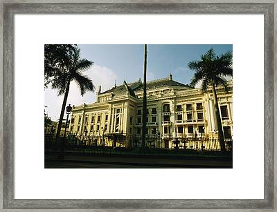 The Hanoi Opera House And Palm Trees Framed Print by Justin Guariglia