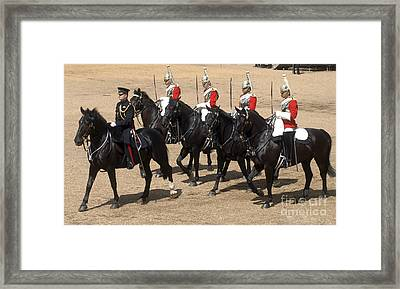 The Household Cavalry Performs Framed Print by Andrew Chittock