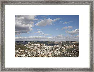 The Jordanian Countryside And The Town Framed Print by Taylor S. Kennedy