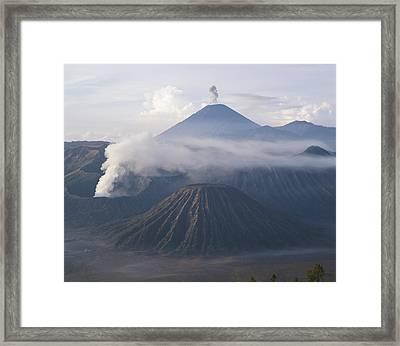 The Peak Of Semaru Rises Above Mount Framed Print by Carsten Peter