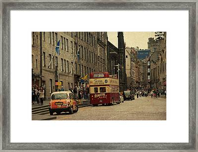 The Princes Street In Edinburgh. Scotland Framed Print by Jenny Rainbow
