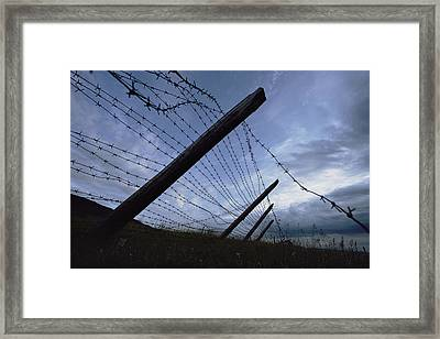 The Remains Of A Barbed Wire Fence That Framed Print by Steve Raymer