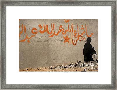 The Shadow Of A U.s. Army Soldier Framed Print by Stocktrek Images