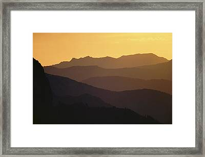 The Silhouetted Mountains Range In Hues Framed Print by Michael S. Quinton