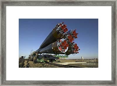 The Soyuz Rocket Is Rolled Framed Print by Stocktrek Images