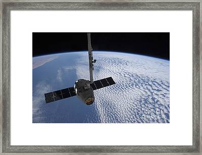 The Spacex Dragon Cargo Craft Prior Framed Print by Stocktrek Images