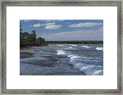 The Surf Breaks On A Beach Framed Print by Raymond Gehman