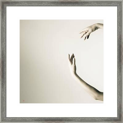The Tilt Hands Framed Print by Nikolay Krusser