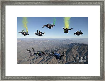 The U.s. Navy Parachute Demonstration Framed Print by Stocktrek Images