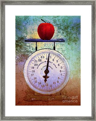 The Weight Of An Apple Framed Print by Tara Turner