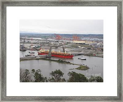 Threading The Needle Framed Print by Sean Griffin