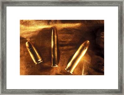 Three Golden 38 Calibre Bullets Framed Print by Lyle Leduc