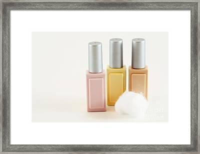 Three Makeup Bottles Framed Print by Blink Images