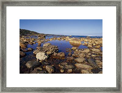 Tidal Pools Fill The Rocky Foreshore Framed Print by Jason Edwards