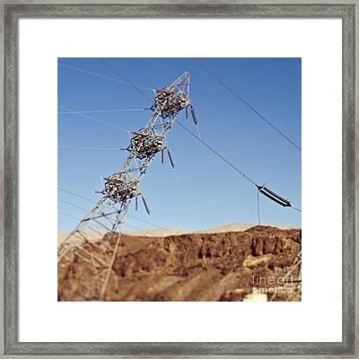 Tipping Pylon In The Desert Framed Print by Eddy Joaquim