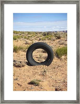 Tire In The Desert Framed Print by Paul Edmondson