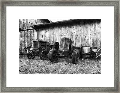 Tired Tractors Bw Framed Print by Peter Chilelli