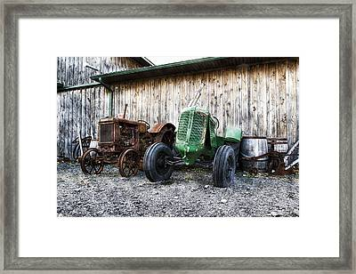 Tired Tractors Framed Print by Peter Chilelli