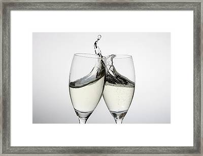 Toasting With Two Glasses Of Champagne Framed Print by Dual Dual