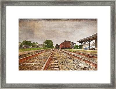 Tracks By The Station Framed Print by Paul Ward